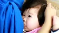 Mother is breastfeeding for her baby video
