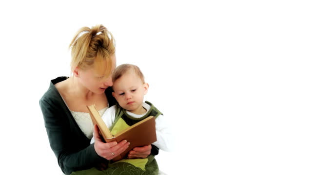 Mother is reading. Liitle child listen of the reading storybook. video