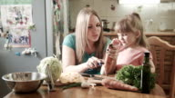Mother peeling carrot with daughter video