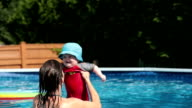 Mother Playing with Baby Boy In Swimming Pool video