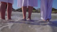 Mother Playing With Children On Beach In Slow Motion video