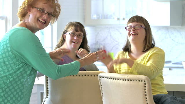 Mother playing with daughters who have down syndrome video