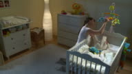 HD CRANE: Mother Playing With Her Sleepless Baby video