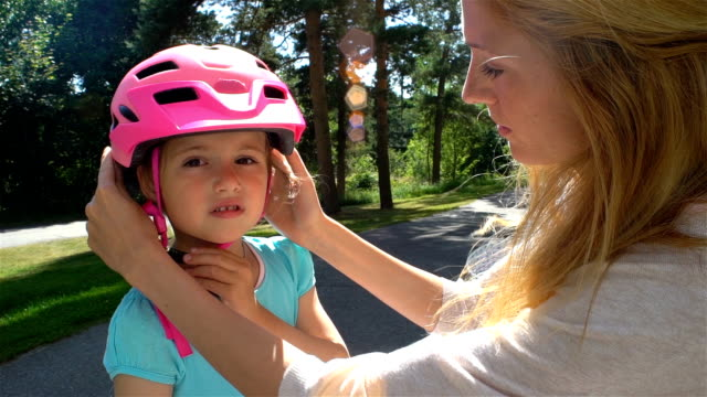 Mother Puts Safety Helmet on is Little Daughter's Head video