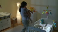 HD CRANE: Mother Putting Baby To Bed video