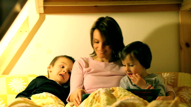 Mother read a book to her two children video