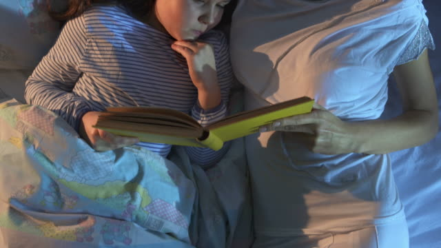 HD CRANE: Mother Reading A Bed Time Story video