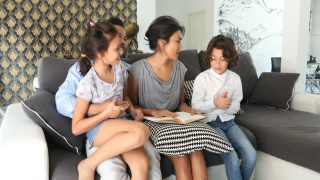 Mother Reading to her Family at Home video