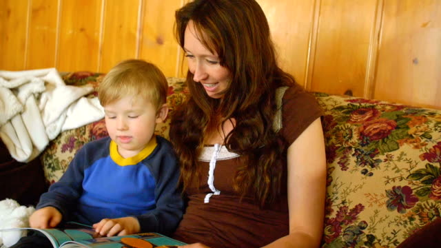Mother reads book to boy video
