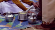 Mother serving a meal to her children video