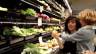 Mother Shopping With Children In Health Food Store video