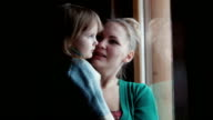 Mother shows to the daughter in a window video