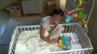 HD CRANE: Mother Stroking Her Sleepless Baby video
