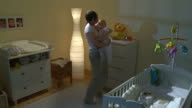 HD CRANE: Mother Taking Care Of Sleepless Baby video