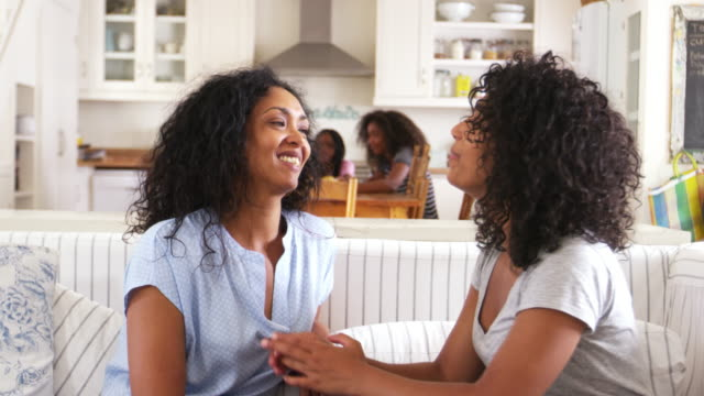 Mother Talking With Teenage Daughter Sitting On Sofa Together video