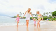 Mother walks with her daughters on the beach video