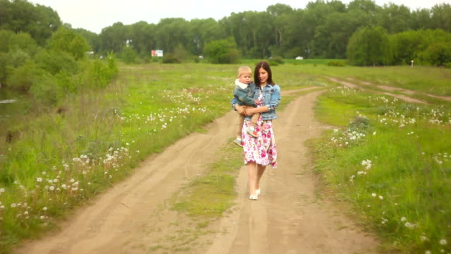 Mother with a child in the open air video