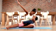 Mother with baby doing stretching exercises video