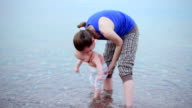 Mother with baby on the sea video