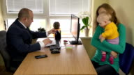 mother with child arms signed divorce papers to lawyer office. video