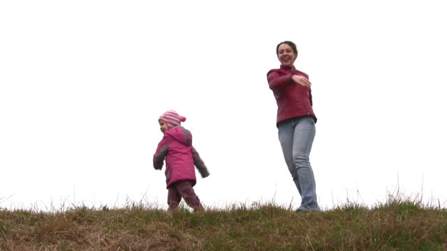 mother with child play on meadow video