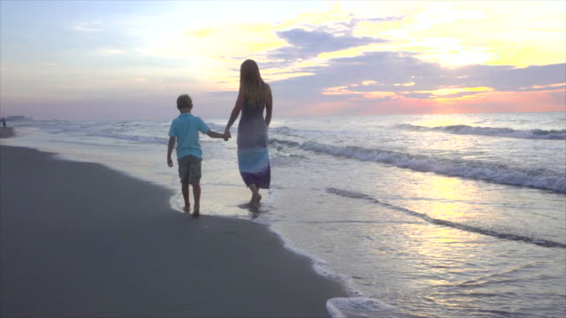 Mother With Children On The Beach video