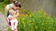 Mother with son having fun in park video