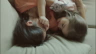 Mothers and daughters cuddling at home video