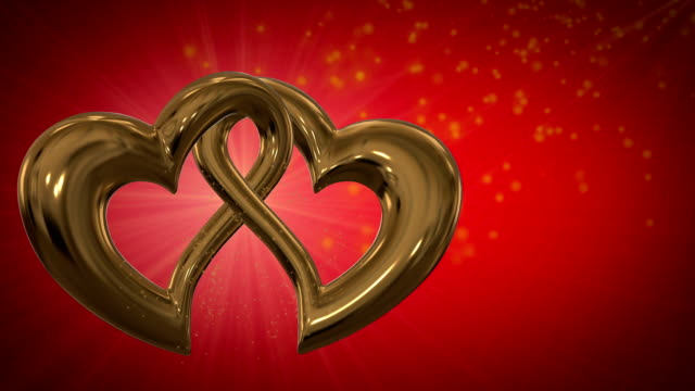 Motion graphic of two intersecting gold hearts video