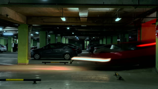 Motion in underground parking of hypermarket ,shopping mall ,time lapse video