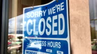 Motion of closed signboard on glass door video