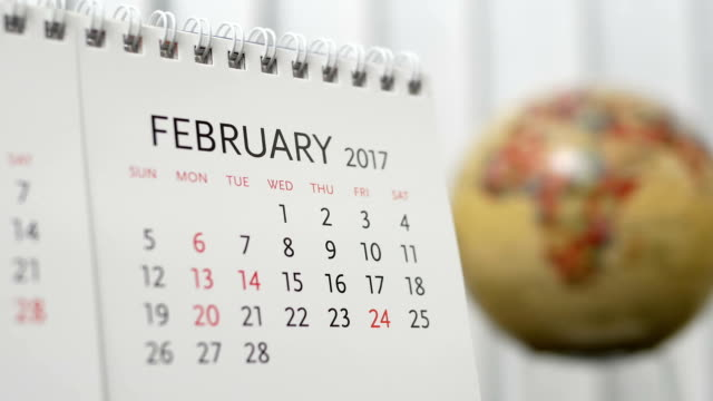 Motion of February 2017 calendar with blur earth globe turning background video