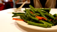 Motion of fresh green beans with smoke inside Chinese restaurant video