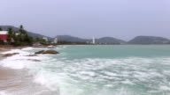 Motion of high speed waves tropical turquoise beach with stone at Kata beach Phuket sea  Thailand video