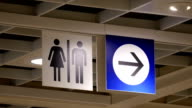Motion of man and woman washroom logo video