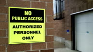 Motion of no public access authorized personnel only sign on wall video
