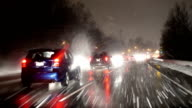 Motion of traffic flow on cold blizzard snow night video