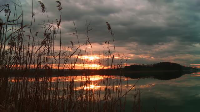 HD Motion Time-Lapse: Beautiful Lake At Sunset video