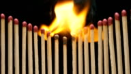 SLOW MOTION: Motivation - Match in center burns and fire goes in sides video