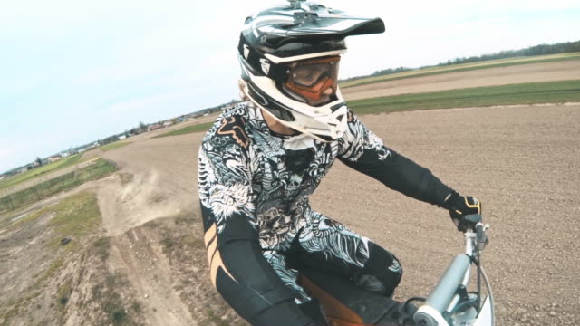 SLO MO POV Motocross biker riding on a dirt track video