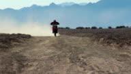 Motocross rider coming towards in desert video