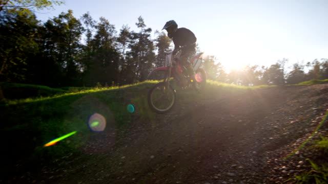 Motocross rider riding downhill video