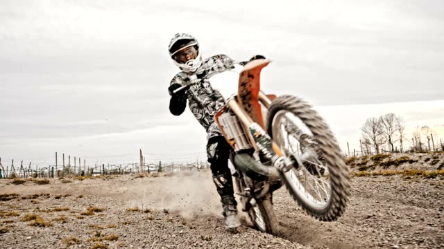 SLO MO Motocross rider riding through rutted turn video