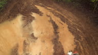 HD CRANE: Motocross Rider Speeding Through Mud video