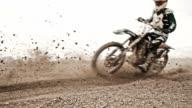SLO MO Motocross riders riding through the turn video