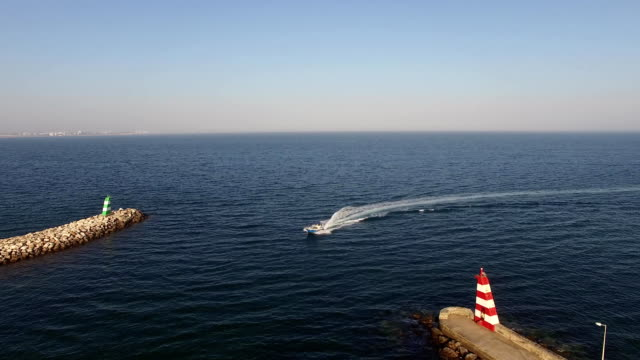 Motor boat enters the harbor of Lagos, Portugal aerial view video
