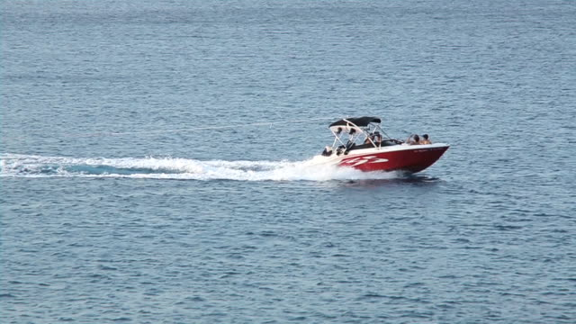 Motor Boat Pulling A Woman At Water Skiing video