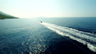 AERIAL Motor Boat Sailing Towards The Sun video