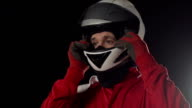 Motor racing / Formula One Driver getting dressed Montage video