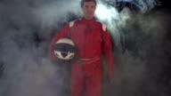 Motor racing / Formula One Driver or Biker walking towards camera video